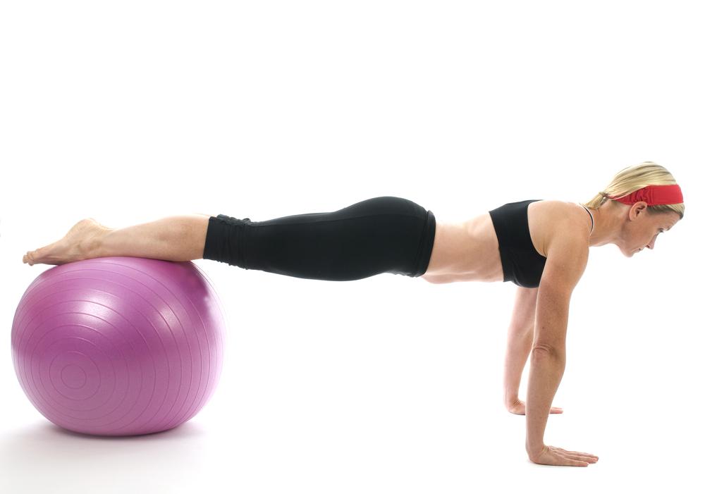 shutterstock_35908486_girl doing pushup on fitball